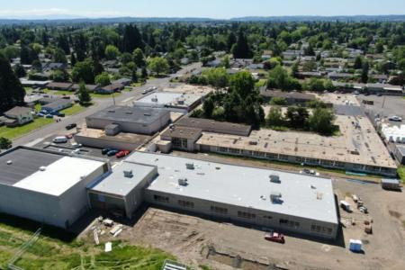 Aerial view of the new classroom wing and multipurpose fitness room. Photo Credit: Triplett Wellman Contractors