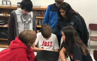 Students try to solve a breakout box