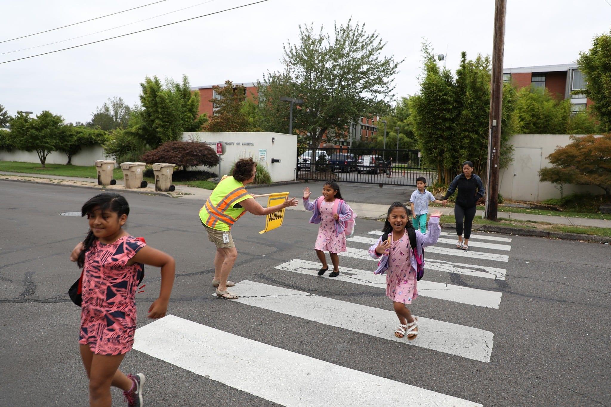 Students walking to school in crosswalk