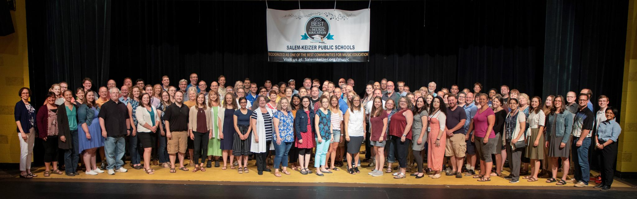 2019-20 Music Department Staff Grouped together on a stage
