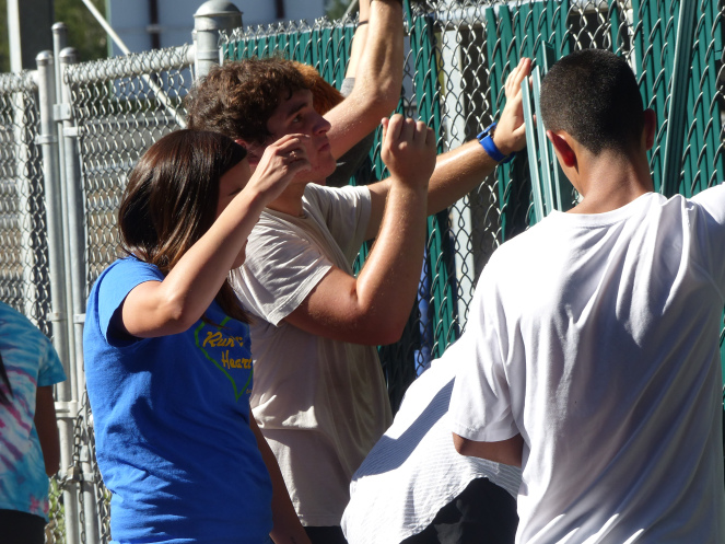 Students helping put fencing in at McKay