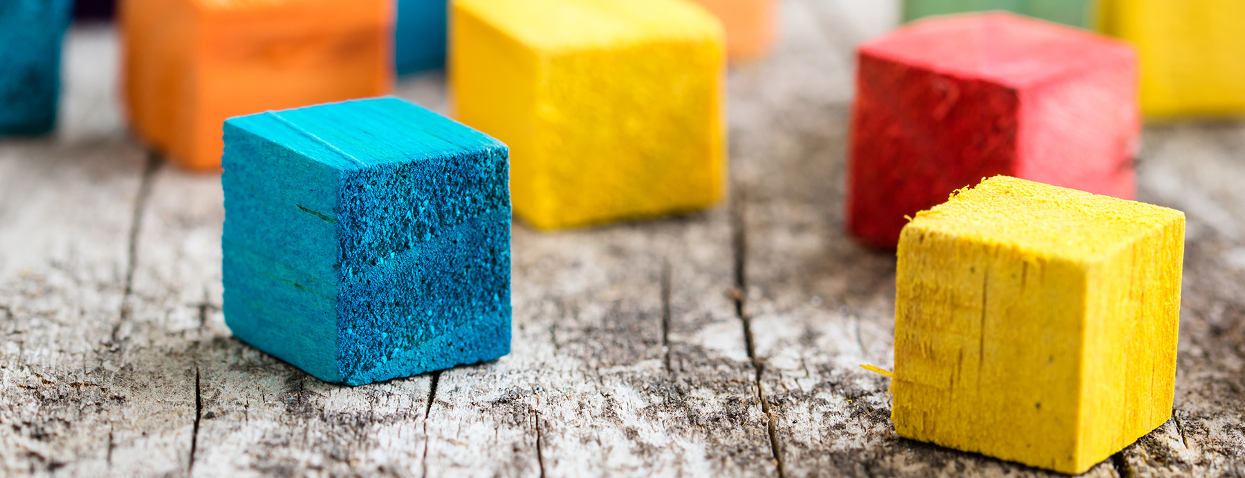 Colored blocks on a wood surface