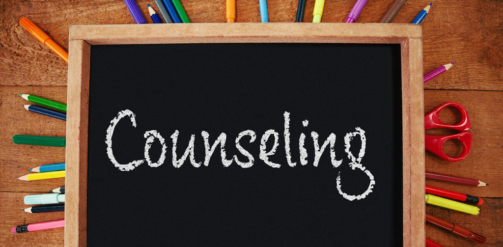 counseling on chalkboard surrounded by pens