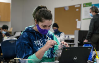 Student with facecovering in cte class