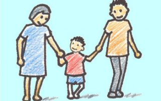 two parents holding hands with child