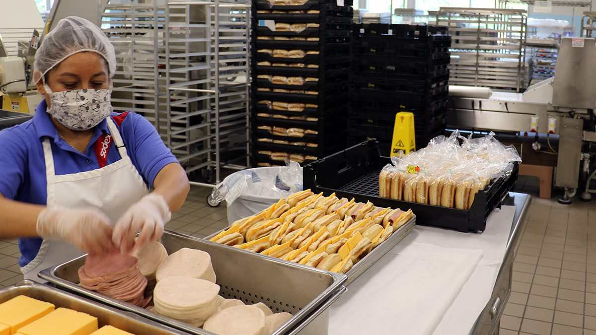 Food services staff making sandwiches