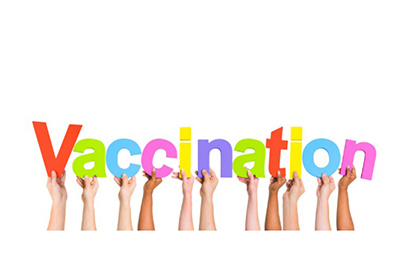Children's hands holding up the word Vaccination