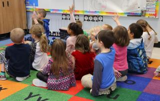 Picture of Keizer Elementary School students seated on a classroom floor