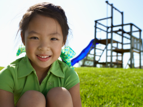 Young girl outside in playground