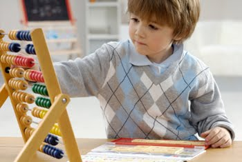 Classroom student using an abacus