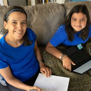 two girls studying on the couch