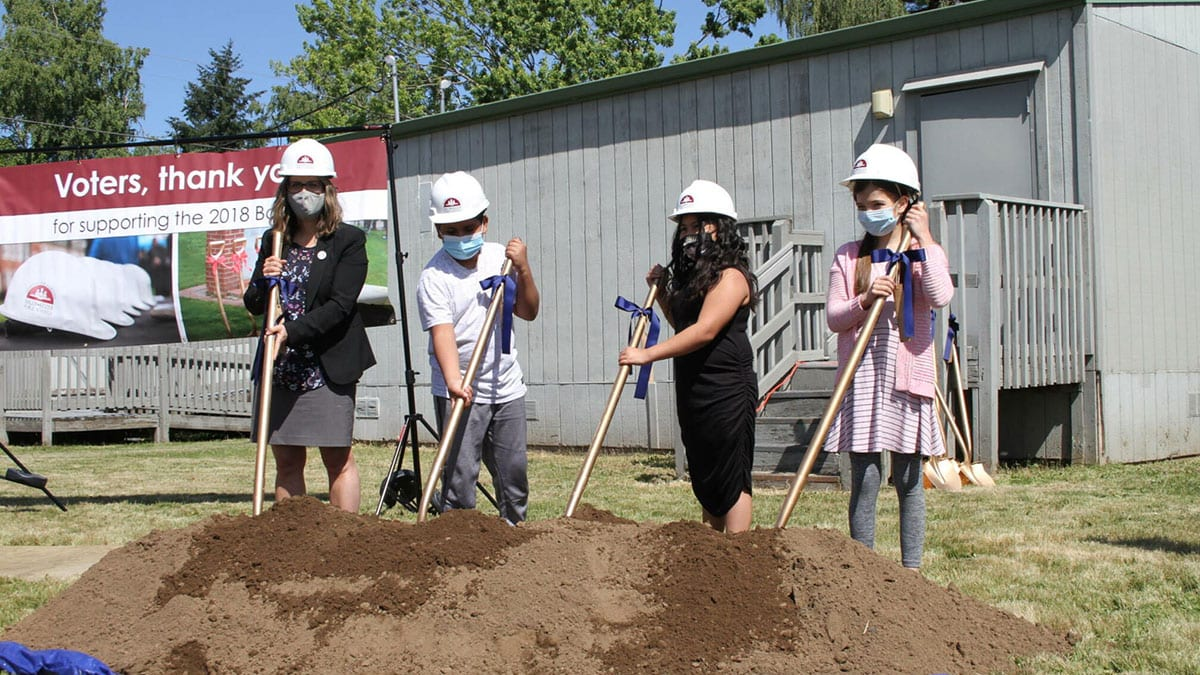 Superintendent Perry with students holding shovels at Kennedy Elementary groundbreaking